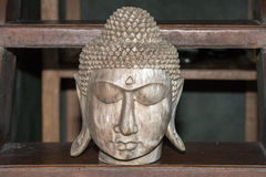 Buddha head closed eyes wooden sculpture statue Royalty Free Stock Photography