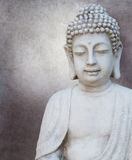 Buddha head. Before a grey vintage background Royalty Free Stock Images