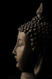 Buddha head isolated on black backdrop Stock Photo