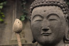 Buddha head and lotos Stock Images