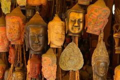 Buddha head masks and carvings Stock Photo