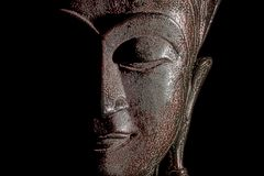 Buddha head. Modern buddhism in focus. Bronze statue face in clo Royalty Free Stock Photo
