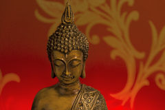 Buddha Head in Red Background. Buddha statue with red background Royalty Free Stock Photo
