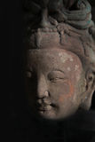 Buddha head statue in shadow Royalty Free Stock Images