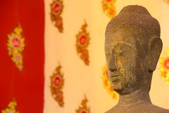 Buddha head statue on Thai Style painting Royalty Free Stock Image