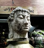 Buddha head stone carving royalty free stock images
