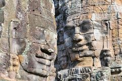 Buddha heads of the Bayon Temple in Angkor Thom, Cambodia. royalty free stock images