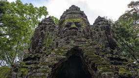 Buddha heads at the south gate of Angkor Thom, Cambodia Stock Photos