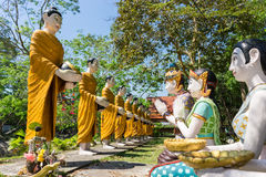 Buddha and his  disciple statue in the forest.  Royalty Free Stock Image