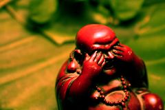 Buddha I. A small Buddha covering his eyes Royalty Free Stock Photography