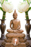 Buddha image. Offer sacrifice lotus flower to buddha image Royalty Free Stock Images