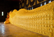 Buddha image. Reclining Buddha image at Wat Thai in Chiangmai Royalty Free Stock Image