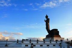 Buddha image with blue sky. At putthamonthon, thailand Royalty Free Stock Photo