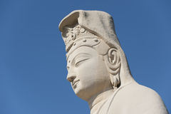 Buddha image, blue-sky background Royalty Free Stock Photo