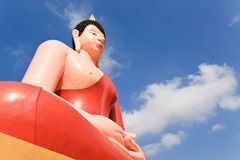 Buddha-image and blue sky background Stock Photos