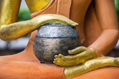 Buddha image with bowl Stock Images
