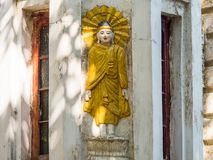 Buddha image on building in Yangon Stock Image