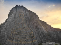 Buddha image carved with laser at the mountain Royalty Free Stock Photography