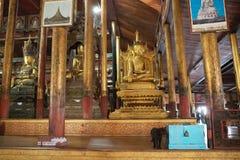 Buddha image and cat at Nga Phe Chaung Monastery Myanmar Stock Photo
