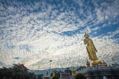 Buddha image and cirrocumulus clouds. Cirrocumulus clouds are appears behind the Buddha image Stock Photography