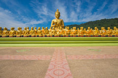 Buddha image with 1250 disciples statue Stock Photo