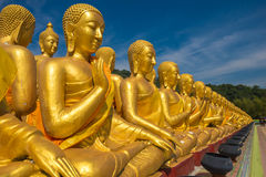Buddha image with 1250 disciples statue Stock Photos