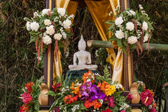 Buddha image and flowers. In the annual Buddhist lent songkran festival Stock Photos