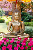 Buddha image and flowers Royalty Free Stock Image