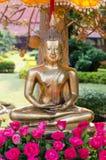 Buddha image and flowers Royalty Free Stock Image