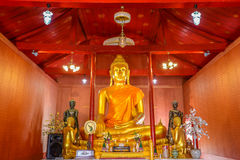 Buddha image with his discuple statues in public Buddhism church. Buddha image with his disciple statues in public Buddhism church of Thailand Royalty Free Stock Photography