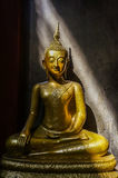 Buddha image in light and shadow Royalty Free Stock Photos