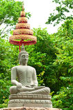 Buddha Image Made From Sand Stone with Trees Royalty Free Stock Images