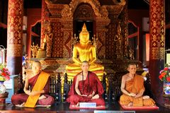 Buddha Image And Monk In Wat Phra Singh, Chiang Mai, Thailand Royalty Free Stock Photography