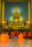 Buddha image and monks in Wat Benchamabopitr Royalty Free Stock Photo
