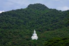 Buddha image on mountain Stock Image