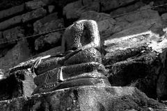Buddha image with no head ancient and bricks background in black and white theme Royalty Free Stock Photography
