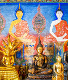 Buddha image with painting on temple wall, Thailand Royalty Free Stock Images