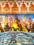 Buddha image with painting on temple wall, Thailand Royalty Free Stock Photography
