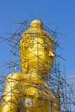 Buddha image reparation on the blue sky Stock Photography