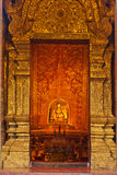Buddha image in sanctuary. With golden door Royalty Free Stock Photos