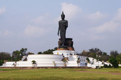 Buddha image standing on blue sky background Royalty Free Stock Images