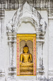 Buddha image statue in concrete wall with Thai stucco decorations frame Royalty Free Stock Image