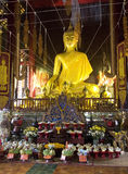 Buddha image in Thailand. Buddha image at a temple in Chiang Mai, Thailand, holding threads and accepting sacrifice during celebration of Loy Kratong Stock Image