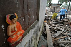 Buddha Image in Tsunami Debris. January 5, 2005 - The image of a Buddha figurine peers out from a house destroyed by the Asian tsunami in Galle, Sri Lanka, which Stock Photos
