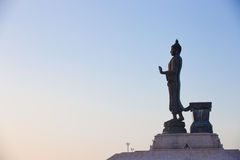 Buddha image in walking posture. With blue sky Stock Images
