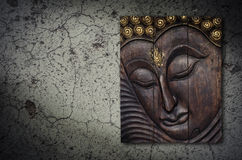 Buddha image in wood graving on the wall Royalty Free Stock Image