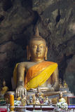 Buddha images in Khao Luang Cave.Non English texts mean the worship words Royalty Free Stock Image