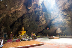 Buddha images in Khao Luang Cave.Non English texts mean the worship words Stock Photo