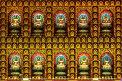 Buddha images on the wall in the temple stock image