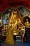 Buddha images at Wat Phrathat Doi Suthep, Thailand. Interior with golden Buddha images at Wat Phrathat Doi Suthep in Chiang Mai, Thailand Stock Photo
